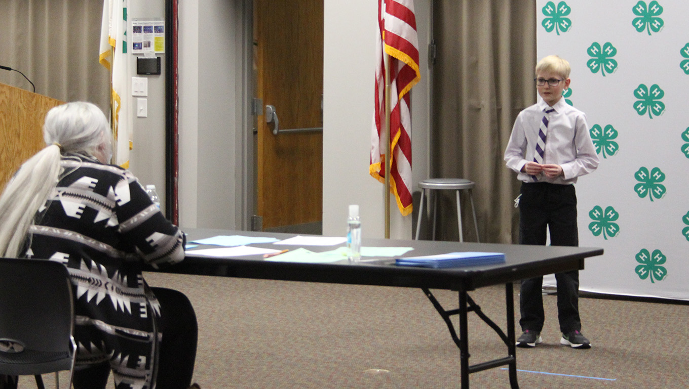boy speaking in front of a judge