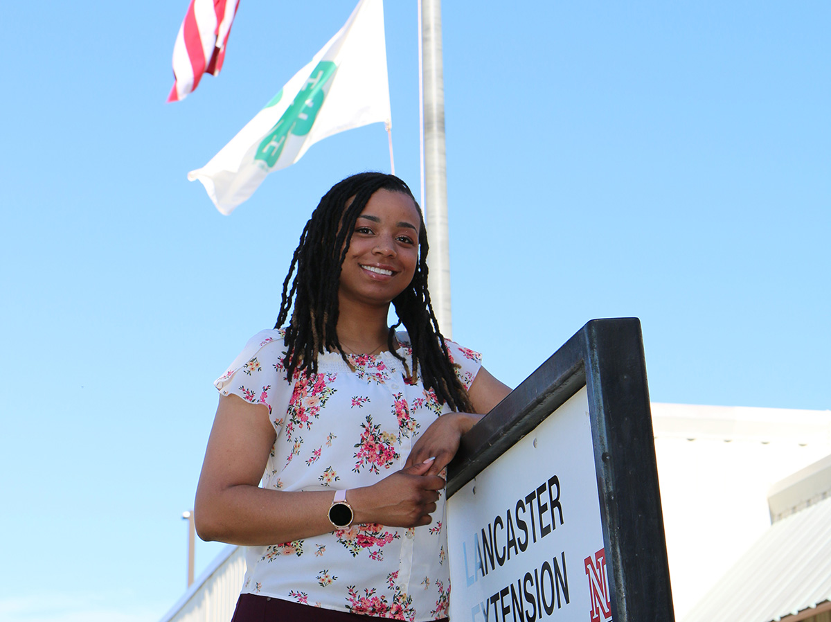 Ericka Murray in front of Extension building