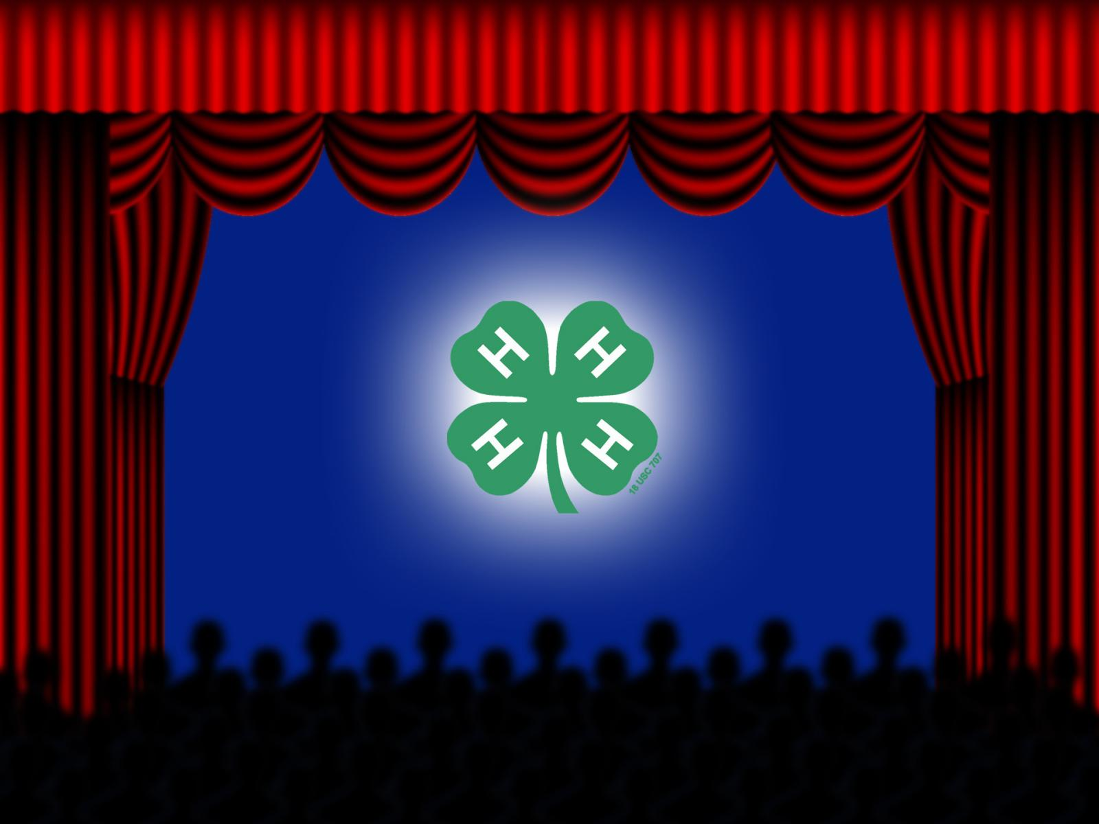 Stage with red curtains and 4-H emblem